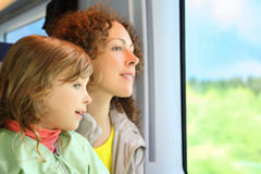 Mother with daughter ride in speed train Stock Photo