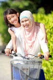 Mother and daughter riding bike Royalty Free Stock Photos