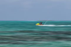 Mother and daughter riding a jet ski. Royalty Free Stock Images