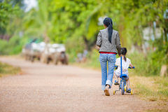 Mother and daughter on the road Royalty Free Stock Images