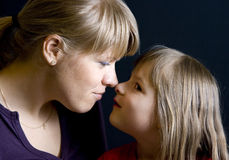 Mother daughter rubbing noses Stock Photography