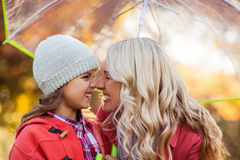 Mother and daughter rubbing noses at park Royalty Free Stock Photos