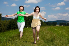 Mother and daughter running Stock Photography