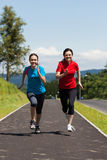 Mother and daughter running stock images