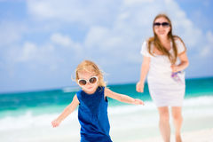 Mother and daughter running at beach Royalty Free Stock Image