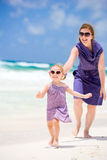 Mother and daughter running at beach Royalty Free Stock Photo