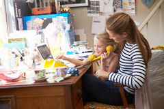 Mother With Daughter Running Small Business From Home Office Stock Images