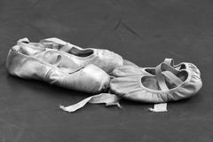 Mother and Daughter. A mother's old dance shoe paireds with her daughters Royalty Free Stock Photos