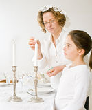 Mother and daughter sabat candels royalty free stock photo