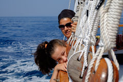 Mother and daughter on a sailboat Royalty Free Stock Photos