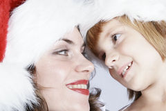 Mother and Daughter in Santa Hats Stock Images