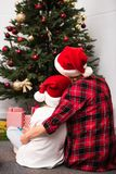 Mother and daughter in santa hats Stock Photography