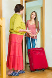Mother and  daughter  saying goodbye at the door Royalty Free Stock Photo
