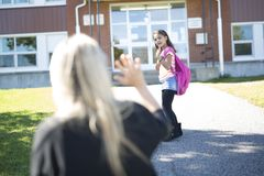 Mother daughter saying her goodbye for the day. A Mother taking her daughter to school, saying her goodbye for the day royalty free stock photo