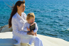 Mother and daughter by the sea Royalty Free Stock Images