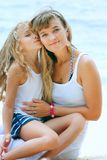 Mother and daughter on sea background Stock Images