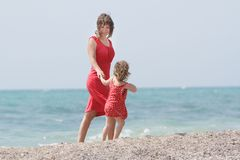Mother and daughter on sea background Royalty Free Stock Image