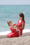 Mother and daughter on sea background Royalty Free Stock Images