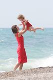 Mother and daughter on sea background Stock Photography