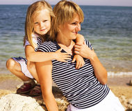 Mother with daughter at sea cost together. Happy family Royalty Free Stock Photos