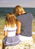 Mother with daughter at sea cost together. Happy family Stock Photo