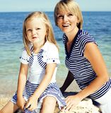 Mother with daughter at sea cost together, happy family. At vacations Stock Images