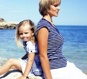 Mother with daughter at sea cost together, happy real family lif. Estyle close up Royalty Free Stock Images