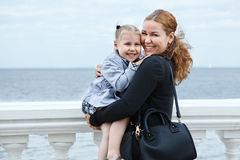 Mother and daughter on sea shore Royalty Free Stock Photography