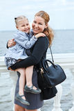 Mother and daughter on sea shore Stock Photography