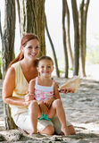 Mother and daughter with seashell stock photo