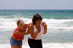 Mother and Daughter on a Seashore Stock Image