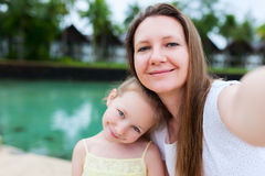 Mother and daughter selfie stock images