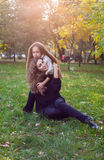 Mother with daughter seven years old in autumn Park at sunset Stock Photos