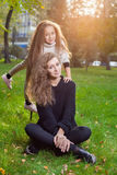 Mother with daughter seven years old in autumn Park at sunset Royalty Free Stock Images