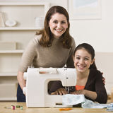 Mother and Daughter Sewing stock photography