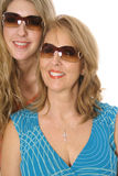 Mother and daughter in shades. Isolated on white Stock Photography