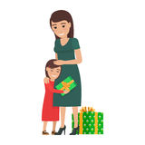 Mother and Daughter Share Christmas Presents. Stock Photos