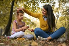 Mother with daughter share love. Mother and daughter share love in city park. Happy mother and cheerful daughter Royalty Free Stock Photos