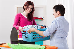Mother and daughter sharing chores Royalty Free Stock Image