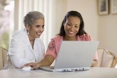 Mother and daughter sharing computer