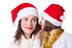 Mother and daughter sharing each other secrets on Christmas Eve. Over white Stock Photo