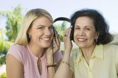 Mother and Daughter Sharing Headphones Royalty Free Stock Images
