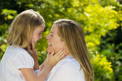 Mother and daughter sharing a moment together outdoors Royalty Free Stock Photography