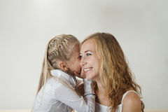 Mother and daughter sharing a secret Royalty Free Stock Image