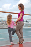 Mother and daughter on ship Stock Photos