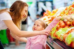 Mother daughter shopping Stock Photos