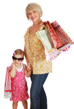 Mother and daughter with shopping bags Stock Images