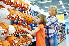 Mother and daughter shopping basketball ball Stock Images