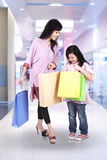 Mother and daughter in shopping center stock photo