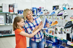Mother and daughter shopping for electric iron Royalty Free Stock Photos
